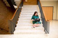 Jordan Davidson studies on the stairs in the MC.