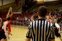 One of three referees watches as the 88ers take a shot during the Men's Basketball Championship Game.