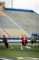 Students in Aimee Zimmer's Soccer class play outside in the Hart Stadium