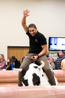 Student, Devin Quiton, starts I-Night by taking a ride on the Mechanical Bull.