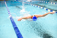 Students of varying swim teams compete in different swimming events.