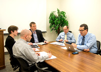 Members of the Perspective Magazine Committee meet to discuss the articles going into the next issue of Perspective.