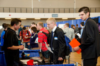 BYU-Idaho students speak to representatives from colleges or companies from their field of study at a career fair held in the I-Center gym