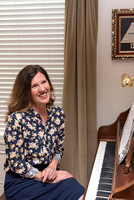 Jill Evans, the Student Development Managing Director, plays the piano in her home. 2017