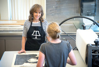 Art professor Carla Jimison speaks with a student about printmaking. 2017