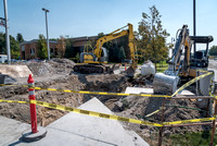 A hole is dug in the parking lot by the Taylor and Benson buildings.