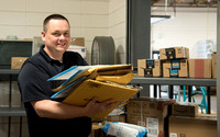 Mail Services supervisor Jim Robison recieving packages from UPS.