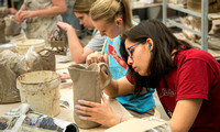 Students work on their clay projects in Art 220, a beginning ceramics class taught by Rich Briggs. Julia James, Feb 2018