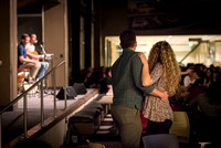 A couple stands up and dances to the music at Acoustic Cafe.