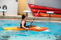 Students for a weekly gathering in the Hart pool to practice kayaking.