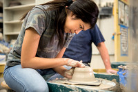 Students work on their clay projects in beginning ceramics class.