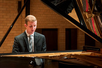 Doug Rowen, a music major, plays the Hamburg Steinway Piano in the Barrus Hall. 2018