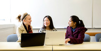 Three female students collaborate in a beginning software development.