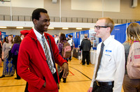 BYU-Idaho students speak to one another at a career fair held in the I-Center gym