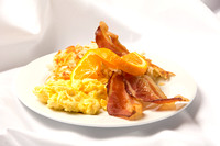Scrambled eggs, choice of meat: Sausage Patties, Link Sausage, Bacon or Ham. Served with Hash Browns and Baker's Choice of Pastry.