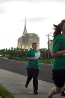 Runners participating in the Temple 2 Temple Relay run past the Rexburg, Idaho Temple on the last Saturday in May during the 2014 Spring Semester.