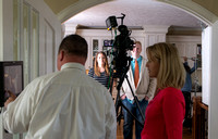 Video crew prepping for a video with President and Sister Gilbert.
