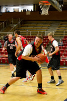 The Knights, Mitchell Hunstman rebounds the ball during the Men's Basketball Championship Game.