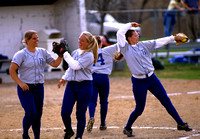 2000 Ricks Softball players do a little mit slapping when taking the field.