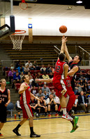 The Knights Josh Heintz goes up against D.J. Elliot and Lance Whitney during the Men's Basketball Championship Game.