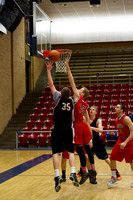 The Knight's Jackson Jewkes drives in to make a layup during the Men's Championship Basketball Game.