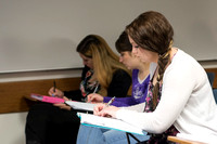 Students takes notes during the 2014 Spring Semester in Sister Glenn's ENG 101 class held in the Kirkham Building.