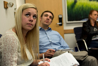 Students look up at the projector to copy down notes in Brother Clay's Social Psychology class.