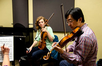 A member of the Shanghai String Quartet working with student ensembles.