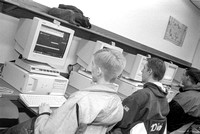 Students work in the Computer Lab on campus. December 1999.