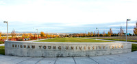 Fall leaves turn colors behind BYU-Idaho sign.