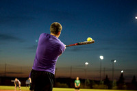 A BYU-I student swings at the ball during a recreational softball game.