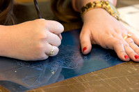 A student in Sister Jimison's Printmaking class works on an assignment during class in the Spori Building.