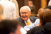 Elder L. Tom Perry, of the Quorum of the Twelve Apostles, chats with other attendees before the concert. Photo by Ryan Chase