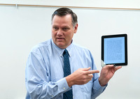 English 252 class taught by Phil Murdock discusses eReaders iPad, Kindle Nook.