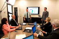 Michael Ballard gives direction for Online Instructor marketing ad. Sean Robertson, acting CEO of boardroom.