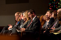Members of the Executive Office sit on the stand during devotional.