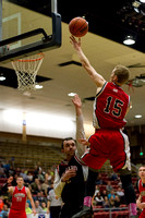The 88er's Austin Houtz reaches up for a layup during the Men's Basketball Championship Game.