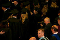 Mike Lewis composes a shot of the graduates as they walking into the I-Center.