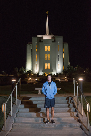 Team members pose by the Rexburg temple before they begin the temple to temple run