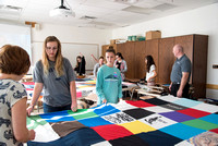Brother Tyler Watson leads students in the Public Health Major in Quilt Tying.
