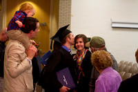 A graduate kisses a loved one after convocation in the Taylor Building.