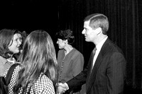 President David A. Bednar and Sister Bednar meeting with members of the audience.