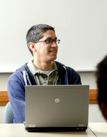 A student pauses and listens for instruction for an upcoming software development test.