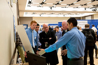 Students display and present their Research & Creative Works in the Manwaring Center. President Clark and Fenton Broadhead take a moment to hear about a students project.