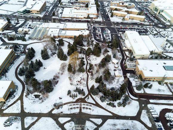 BYU-Idaho campus covered in a light blanket of snow.