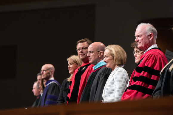 President and Sister Gilbert stand at the start of convocation with Elder L. Whitney Clayton and Sister Clayton.