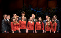 A choir sings at devotional.