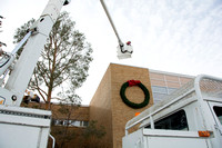 Construction Workers taking down Christmas Decorations