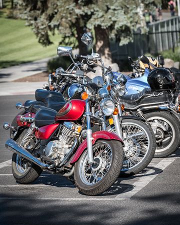 A row of motorcycles are parked on the BYU-Idaho campus. 2017
