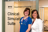 Dixie Jamison, of the Nursing department, and Sarah Skousen pose for a photo in the Simulation Suite.